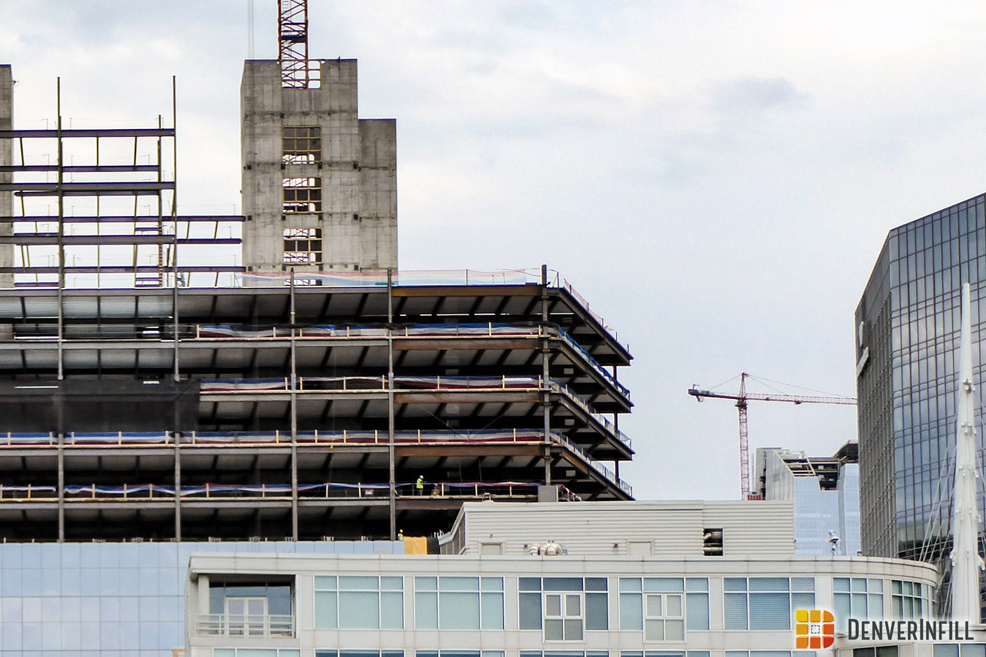 View from Commons Park with 16 Chestnut on left and the crown of 1144 Fifteenth under construction at lower right