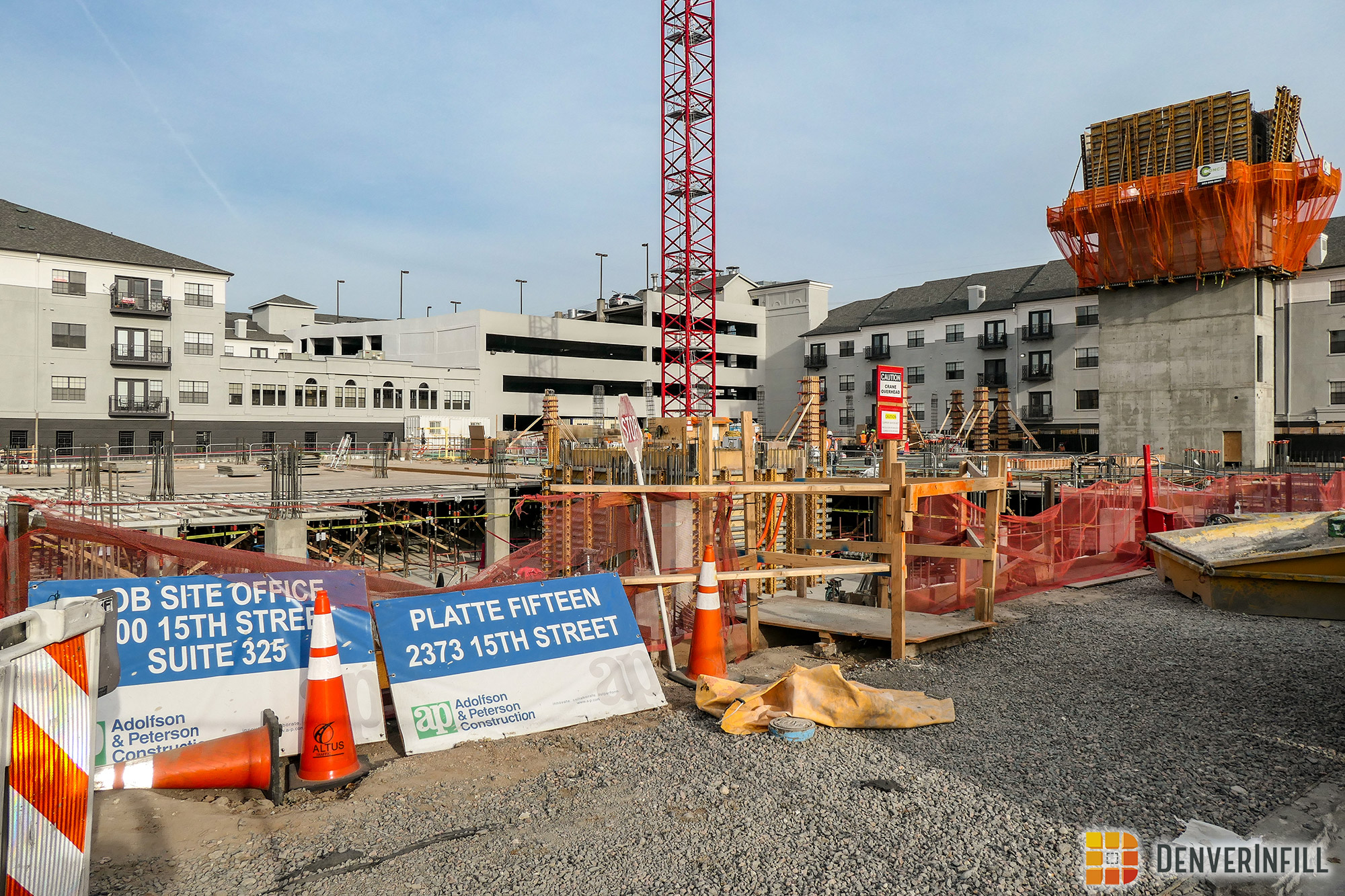 Close-up of construction at the corner of 15th and Platte