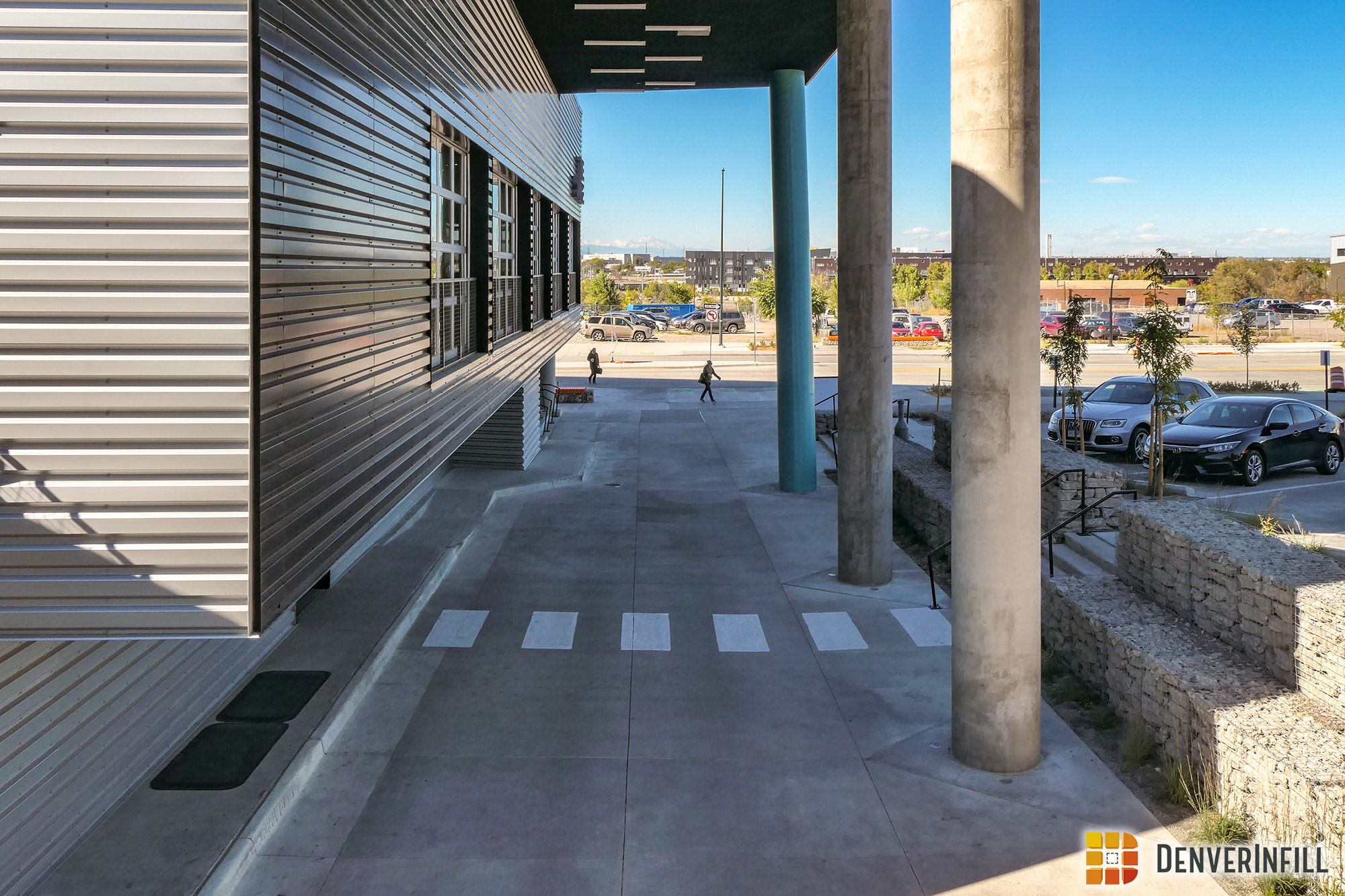The Source Hotel's valet and parking garage access below the pedestrian walkway