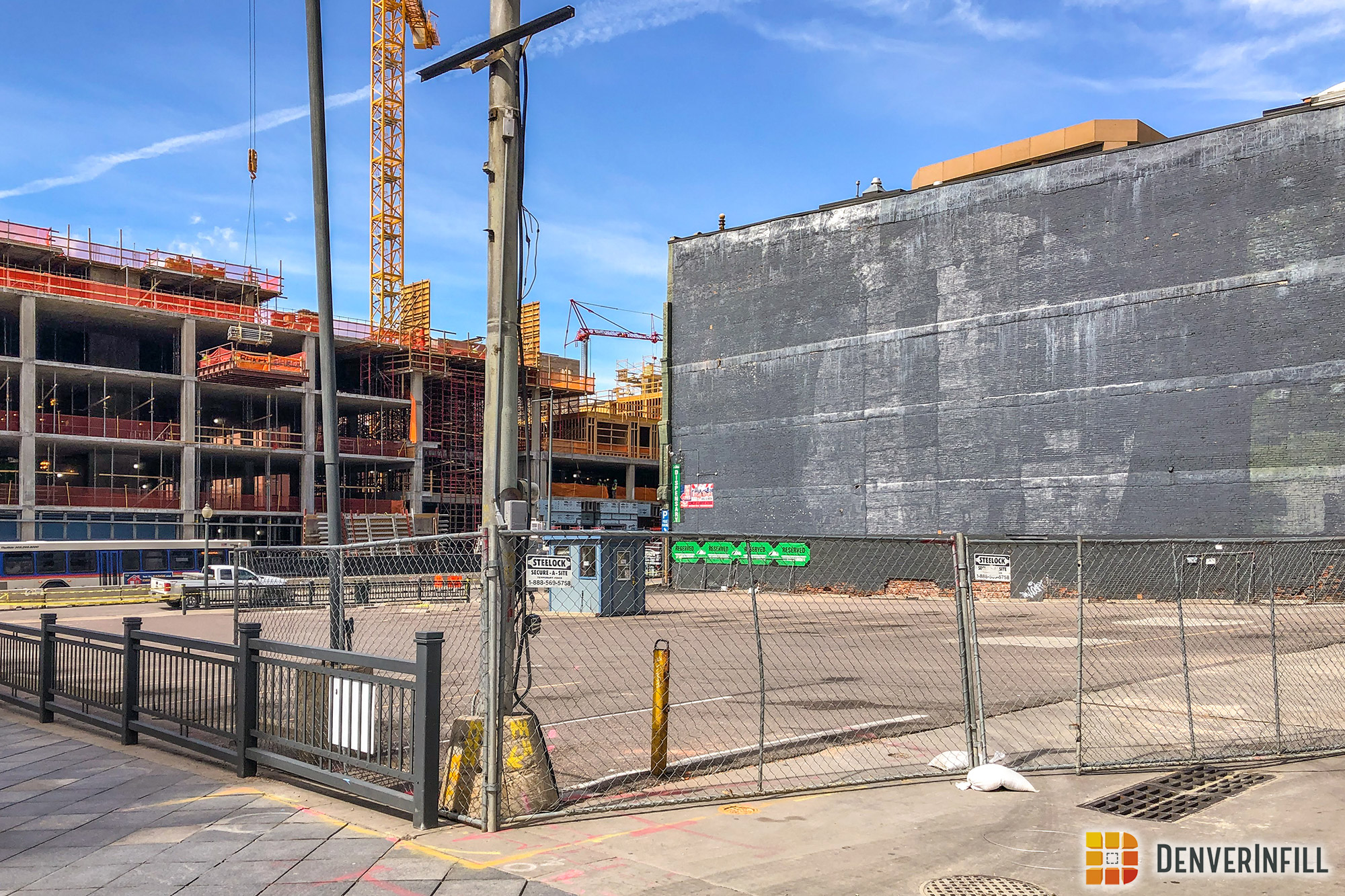 Parking lot closure at 16th and Market in preparation for construction of the Thompson Denver hotel