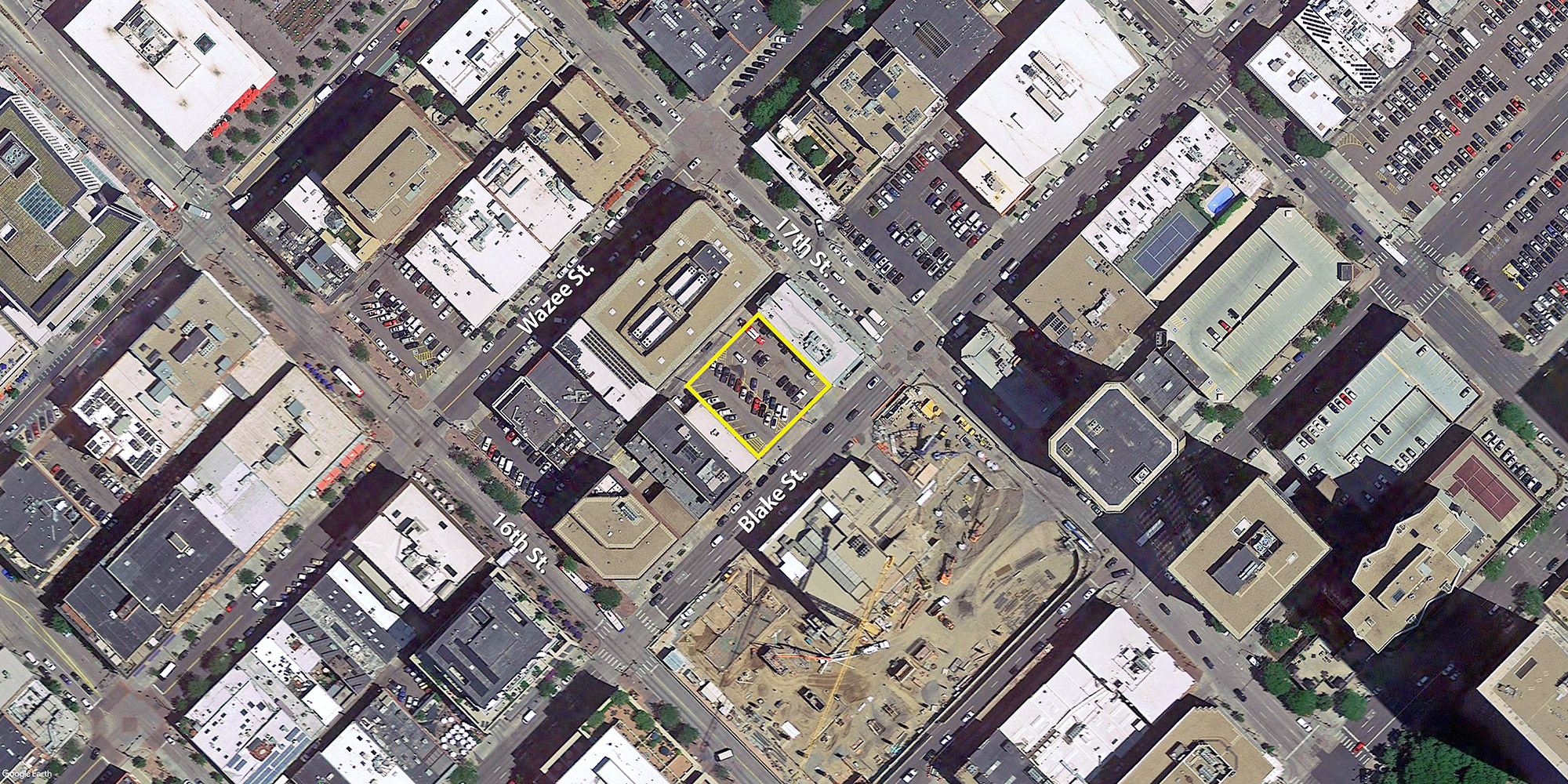 Site location for the proposed 1637 Blake Hotel, aerial image courtesy of Google Earth